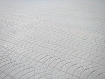Square pavement tiles. A tiled pavement as a background Royalty Free Stock Photo