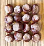 a square of peeled chestnuts on a natural brown mat stock photography