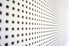Square perforated sound barrier. Wood wall white acustic grate metal texture wallpaper steel surface iron abstract background hole structure metallic grid royalty free stock photography