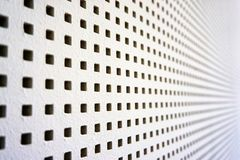 Square perforated sound barrier. Wood wall white acustic grate metal texture wallpaper steel surface iron abstract background hole structure metallic grid stock photo