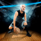 Square  photo of basketball player in action dribbles in the gam Royalty Free Stock Photos