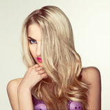 Square photo of beautiful blonde girl in studio Royalty Free Stock Image