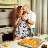 Square photo of beauty couple in love flirting at house party Stock Photos