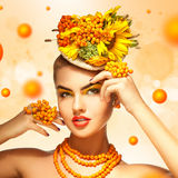 Square photo of Beauty fashion model with orange rowan Hair Styl Royalty Free Stock Images