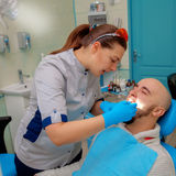 Square photo of patient on the examination of the teeth at the d stock image
