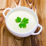 Square photo of potato and onion vegan, vegetarian healthy cream soup in white ceramic bowl. Top view. Tasty potato soup with a le Royalty Free Stock Photos