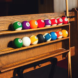 Square photo Set of balls for a game of pool billiards on shelve Royalty Free Stock Images