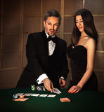 Square photo of sexual couple in elegant suit to play poker Stock Photo