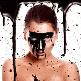 Square photo of woman with paint on face Royalty Free Stock Photo