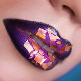 Square photo of woman lips with creative make up. macro Stock Photos