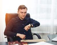 Square picture of businessman looking on his wrist watches stock images