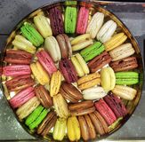A square picture of a round box of colorful macaroons made in Paris Stock Photo