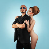 Square picture of serious strong man with hot naked woman Royalty Free Stock Photography