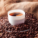 Square picture of white cup with coffee Royalty Free Stock Photography