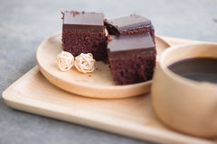 Square piece of chocolate cake with cream filling. Selective focus stock photo