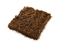 Square piece of soil. Isolated on white royalty free stock photography