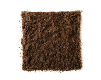 Square piece of soil. Isolated on white stock photography