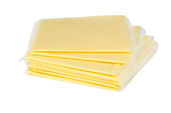 Square pieces of cheese in plastic Stock Images
