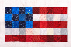 Square pieces of fabrics lying like a flag of USA Stock Photos