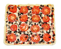 Square pizza with vegetables ready to be cooked Royalty Free Stock Photos