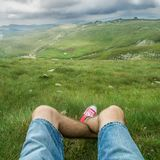 Point of View of Man Legs at Mountain Plateau royalty free stock images