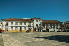 Square with the Polytechnic Institute old mansion. Deserted square with old large mansion on background and parked cars on sunny day at Portalegre. A nice little royalty free stock images