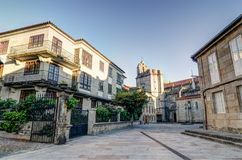 A square in Pontevedra Spain with a church as background and some buildings with plants and a spanish flag.  Royalty Free Stock Photography