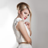 Square portrait of beautiful adult girl with creative hairstyle Stock Image