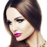 Square Portrait of a beautiful young woman. The beauty of classic, black and gold makeup, fuchsia lips. The concept of Royalty Free Stock Photography