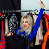 Square portrait of fun beauty young blonde woman in clothing sto Stock Image