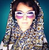 Square portrait of a girl in a headscarf. Square portrait of a girl in a scarf and goggles Stock Image