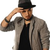 Square portrait of glamour young man in hat and jacket looking a royalty free stock photography
