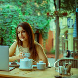 Square portrait of young business woman with cup of tea in resta Royalty Free Stock Photo
