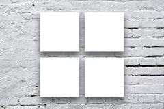 Square Posters hanging on the art gallery wall Royalty Free Stock Images