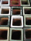 Square Pots. Top view of colored square ceramic pots royalty free stock images