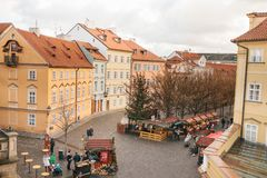 Prague, December 24, 2016: Shopping tents on the square next to the Charles Bridge. Christmas market. Happy local royalty free stock photo