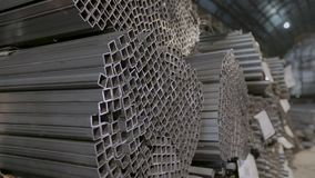 Panoramic view of a large warehouse with metal. Profile pipe in a covered warehouse, profile pipe laid in rows in a. Square profile pipe, metal warehouse. Clean stock footage