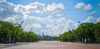 Square of public park with blue sky and clouds Stock Images
