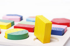 Square puzzle peg round hole Royalty Free Stock Image
