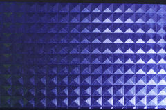 Square pyramidal blue stripped pattern texture illuminated neon plastic glow Stock Image
