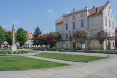 The square in Pyskowice with the town hall and the column with the statue of the Virgin Mary. Stock Image