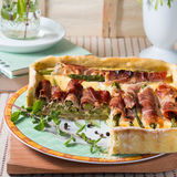 Square quiche with asparagus, ham and herbs Stock Image