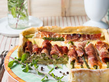 Square quiche with asparagus, ham and marjoram Stock Images