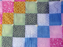 Square quilt. Colorful square quilt used as a background Royalty Free Stock Photos