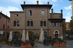 A square in Ravenna with beautiful buildings in classic style, Italy royalty free stock photos