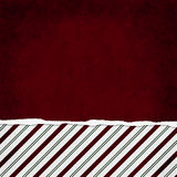 Square Red, Green and White Candy Cane Stripe Torn Grunge Textured Background. With copy space at top royalty free stock image