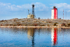 Square red and white lighthouse. In Utö, Finland royalty free stock photography