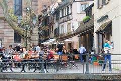 Square with the restaurant in Strasbourg at the Ill river Royalty Free Stock Image