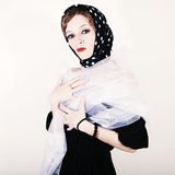 Square retro portrait of a young woman in headscarf Royalty Free Stock Photos