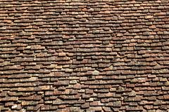 Square roof tiles plain clay pattern weathered. Aged Pyrenees architecture detail Stock Photography